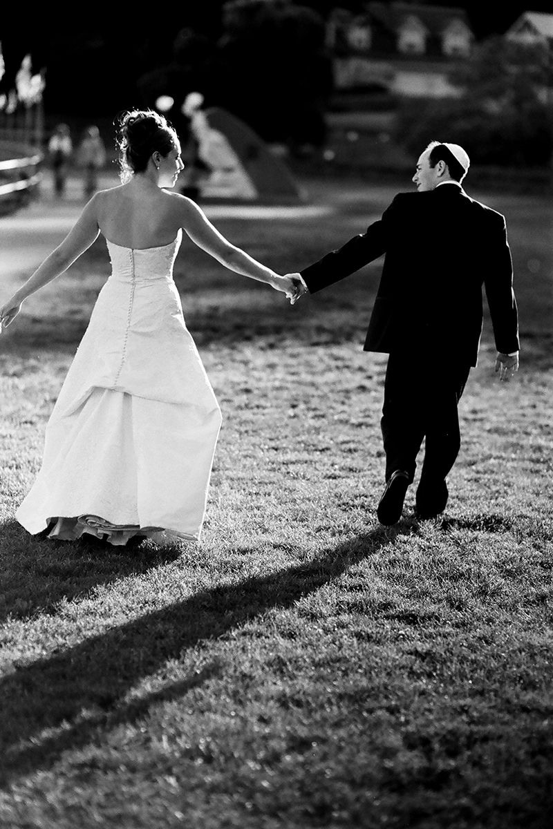 Bride and groom exit the ceremony just after the kiss at Rosario Resort on Orcas Island, WA