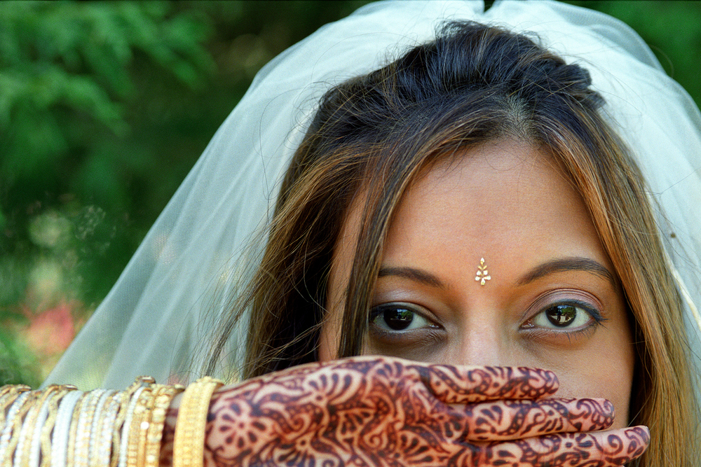 Bride and henna at wedding at Woodland Park Zoo in Seattle, WA