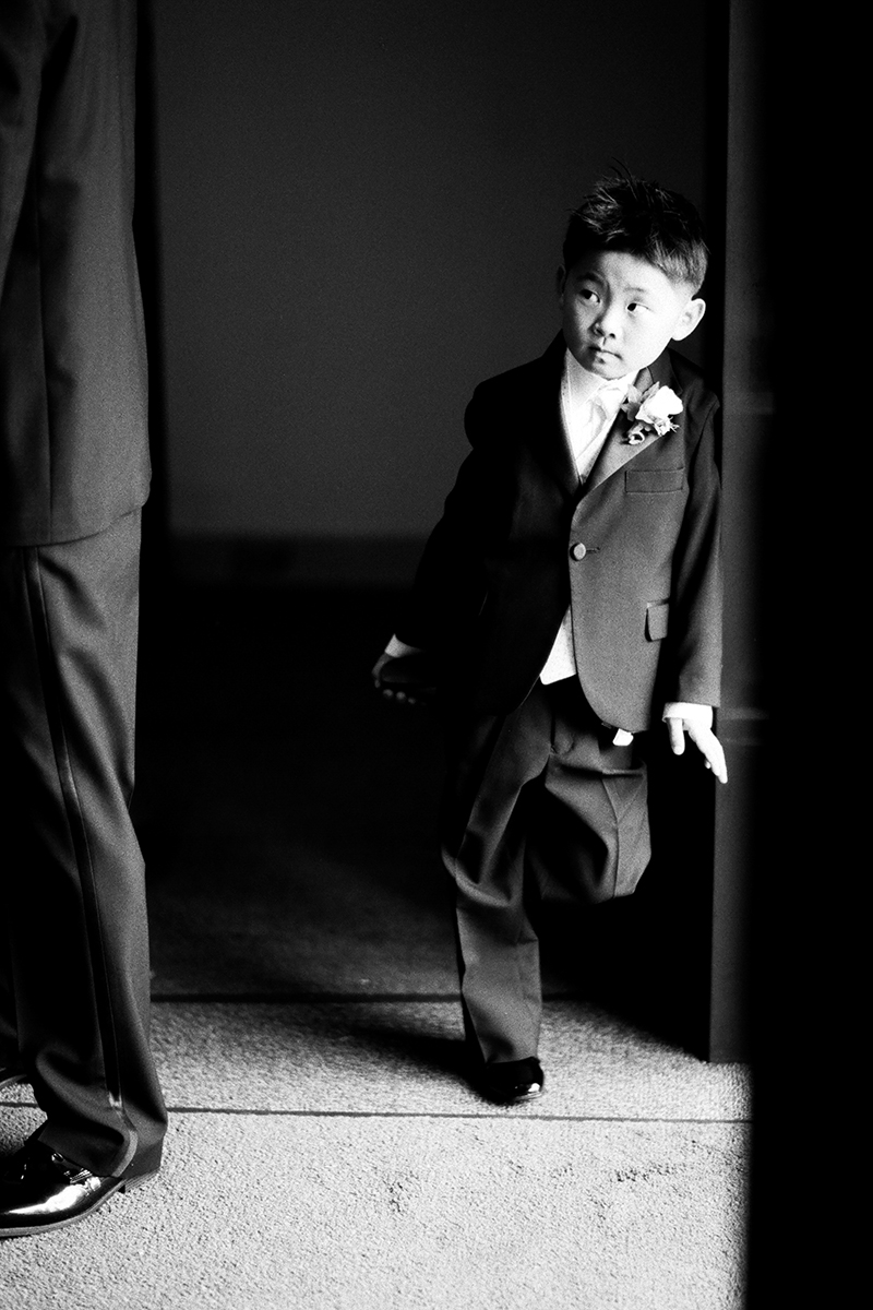 Ring bearer watching the groom at a wedding in Seoul, Korea