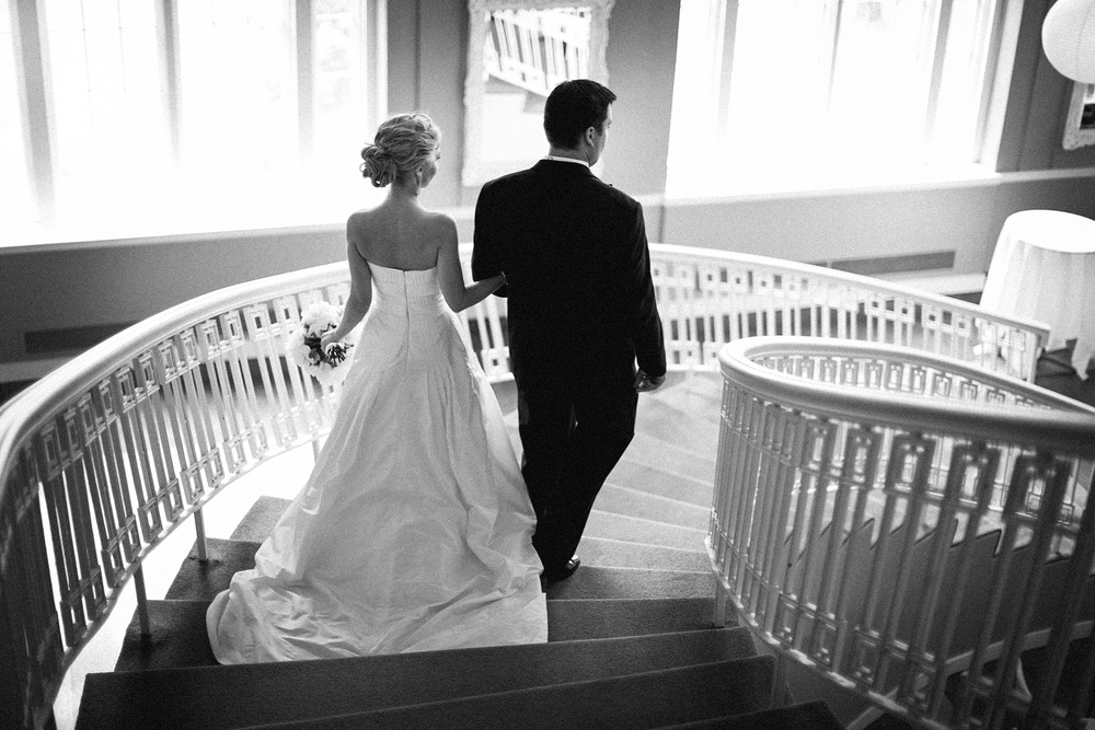 Bride and groom walk down to their reception at Calhoun Beach Club in Minneapolis, MN