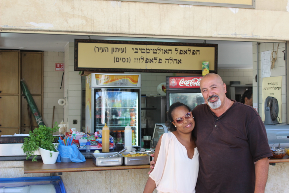With Nassim, in front of the falafel shop that has been in his family for over fifty years.  Not only was his Schnitzel excellent, he gave me extra falafel on top!