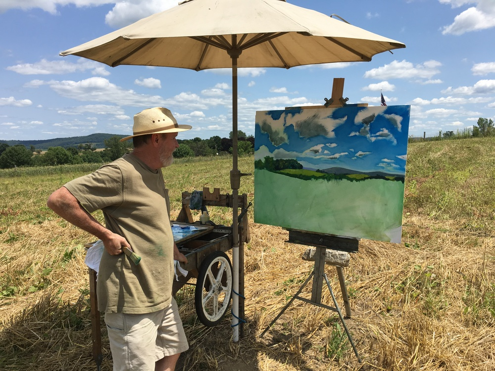 ChaNorth resident Dan making his painting in the plowed field.  Check out his hand made plein air painting set up.  He's been doing this for years and has it all worked out.