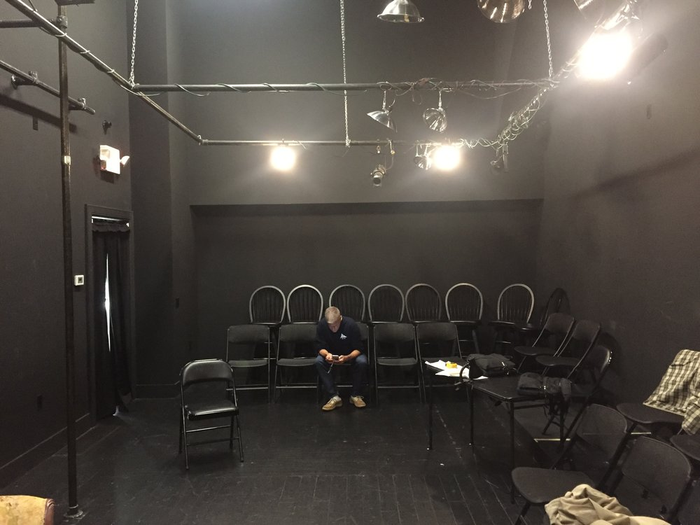 End to end at the black box – a marvelously intimate space to perform, but echo-y as heck. Note the clamp-on lights with the aluminum shades – just a few paper clips and gel and we were golden. (Rob Phelps – my man – is checking his email.)