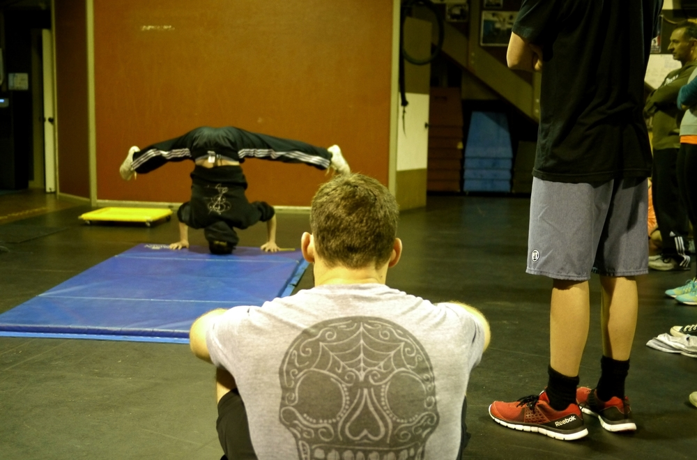 Laurie doing a press to handstand