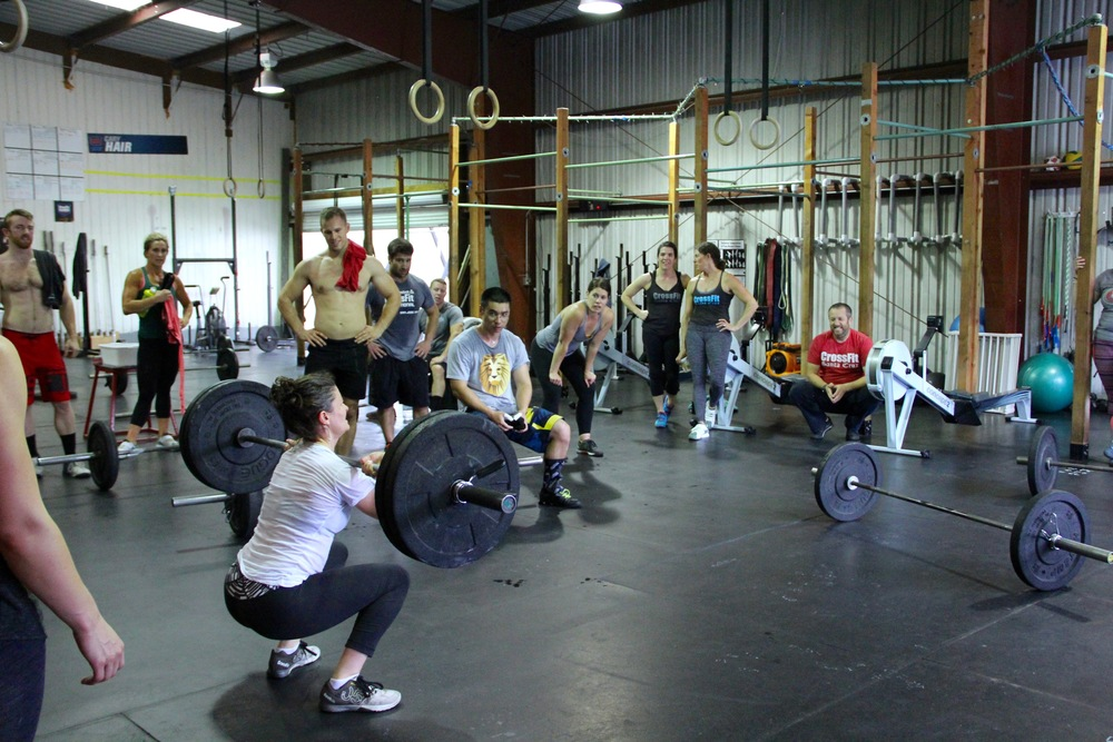 The 10 a.m. Saturday class cheering on Kim and her team on the last few reps.