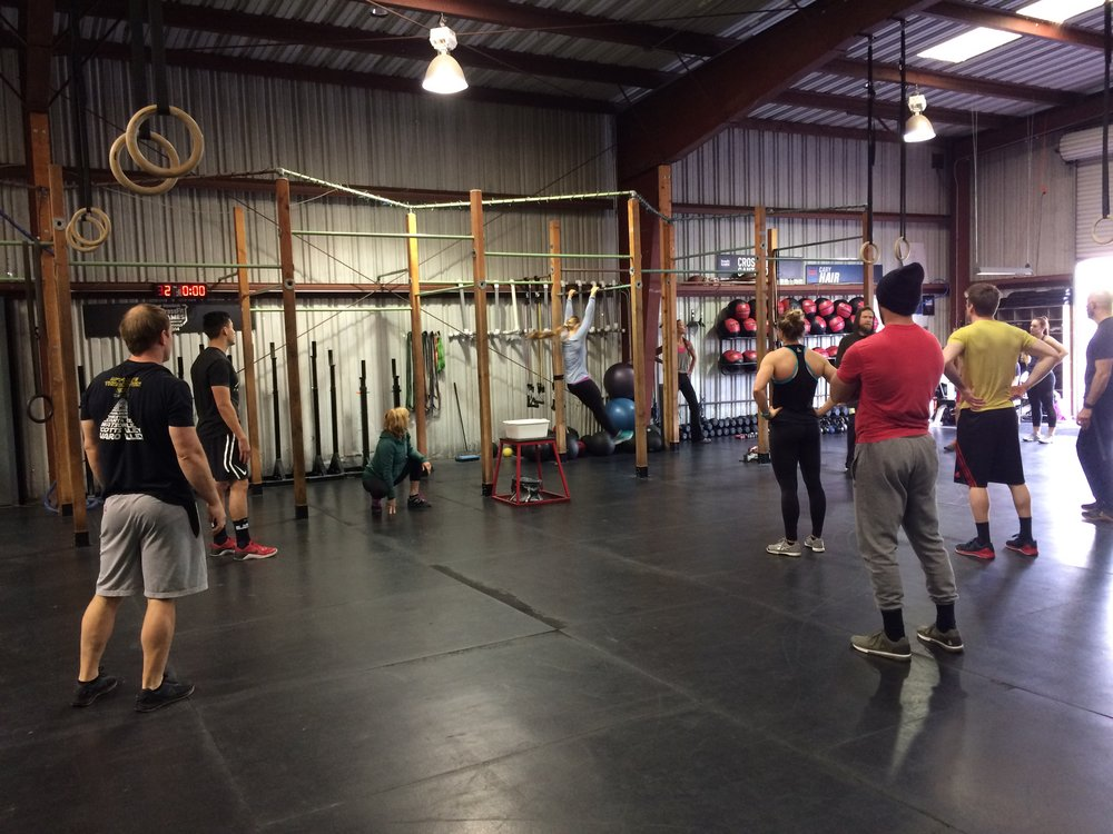 New Year's Eve class watching Bailey demo a movement