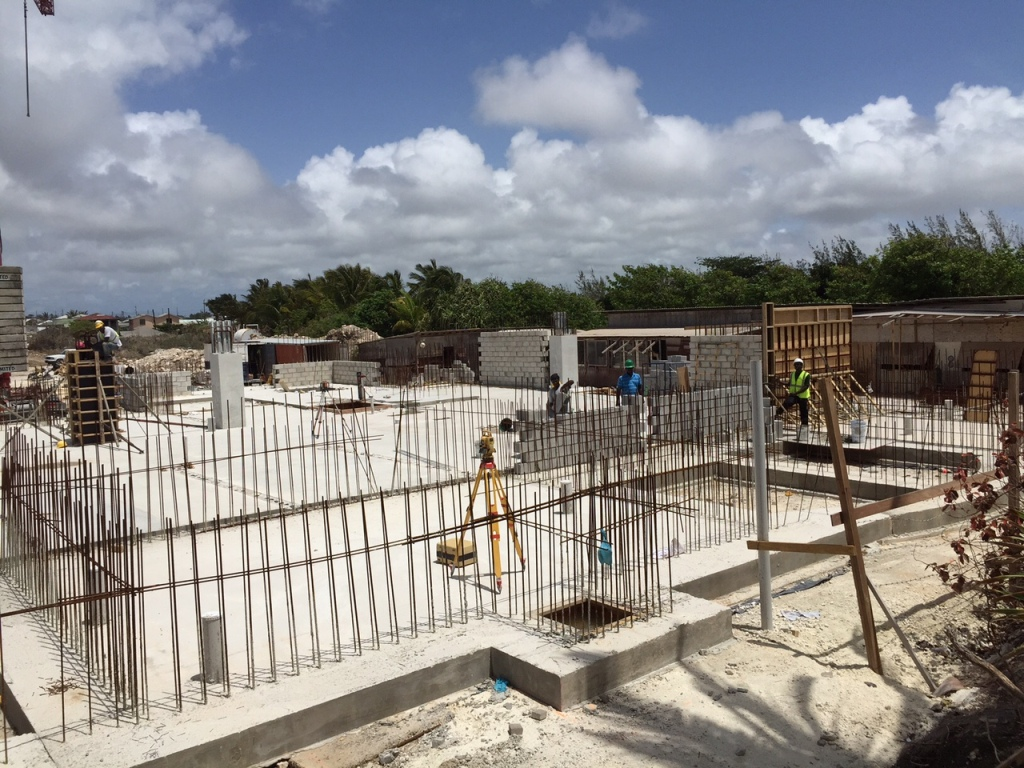 After the final concrete pour. Here we see the blockwork, columns and walls going up.