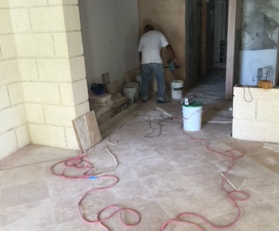 Ongoing tiling and smooth plaster finish works