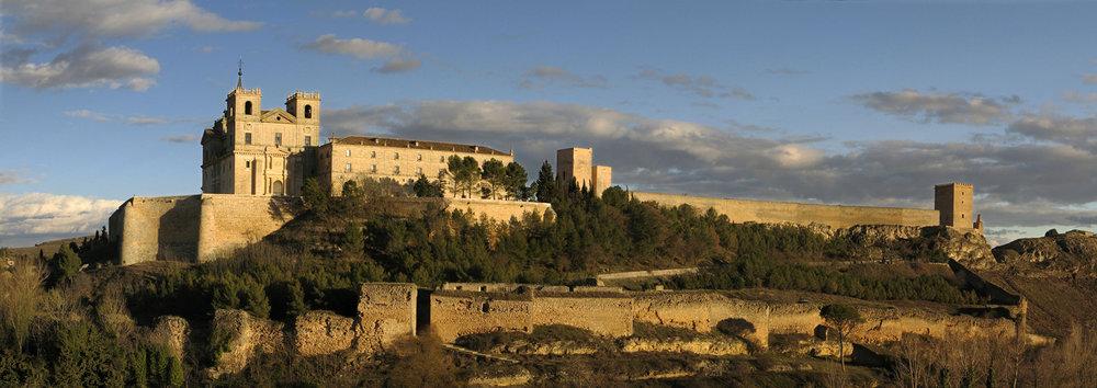 Monastery de Santiago de Uclés on a hilltop overlooking vineyards