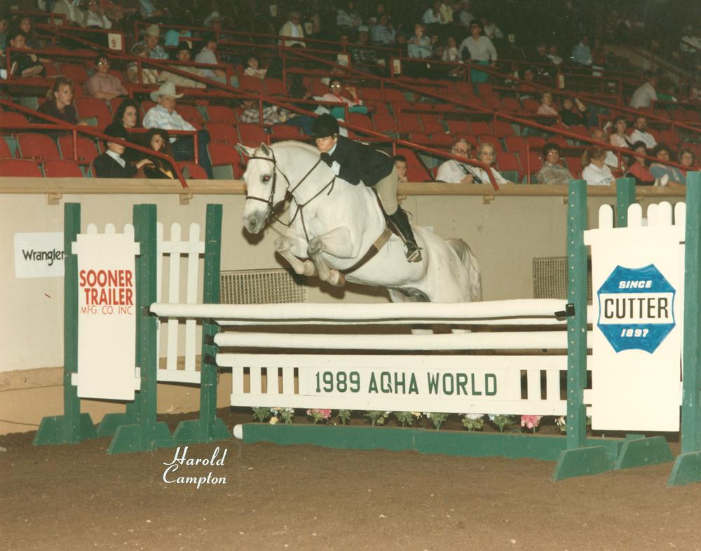 Colleen jumping Gray horse.jpg