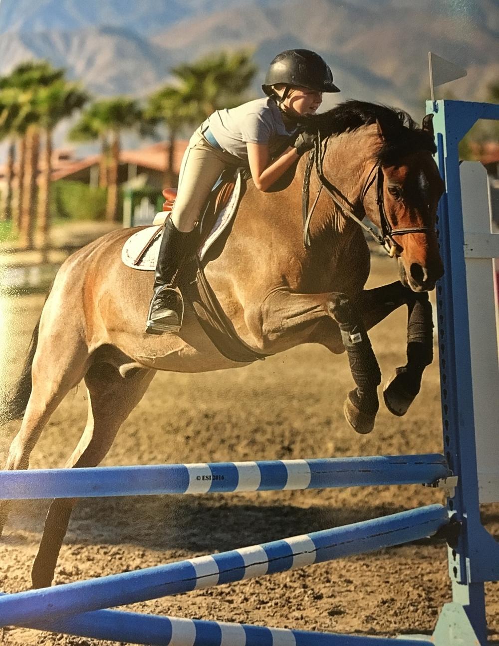 Carlee jumps Melin.JPG