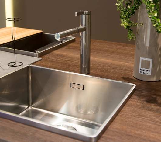 Above A Sink With A Beautiful Form Featuring An Edge With An Interesting Modern Dimension