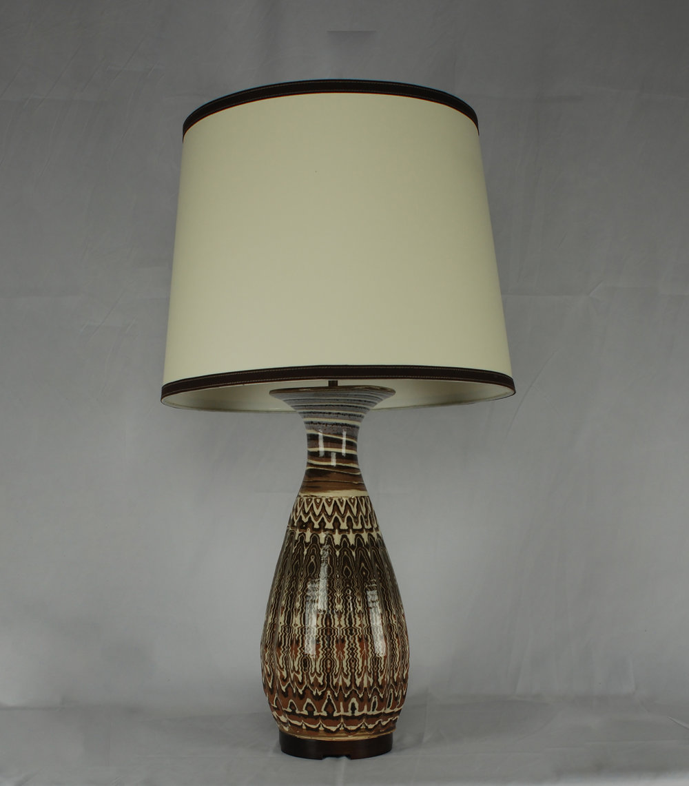 "Karnak table lamp in agateware clay and clear glaze 1"" tall reclaimed walnut base with paper parchment drum shade with coco Ultrasuede trimming."
