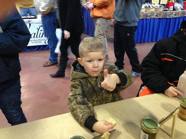 farm-show-boy-tasting-thumbsup.jpg
