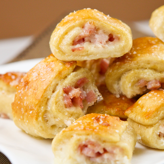 These delicious bites are the PERFECT party or game day food! A ham and cheese combo are wrapped up perfectly in a salty and buttery crust to make the ...