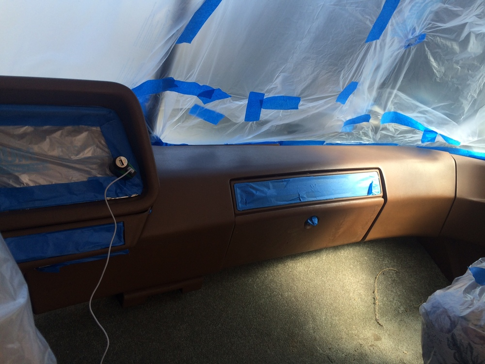 Before: Poopy brown dashboard cleaned and taped off.