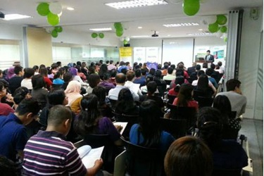 Students listen to welcoming remarks by adrian siew
