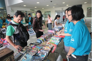 Visitors browse through books on sale at charity fair