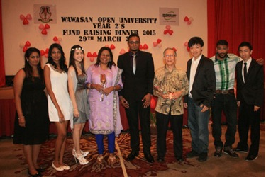 WOU's Jasmine Emmanuel (4th from left) at the fundraising dinner