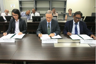 (From left): Loh Shy Tyug, Prof Ho and Kumar Ghosh sign the agreement