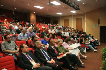 Participants attend the opening of the symposium.