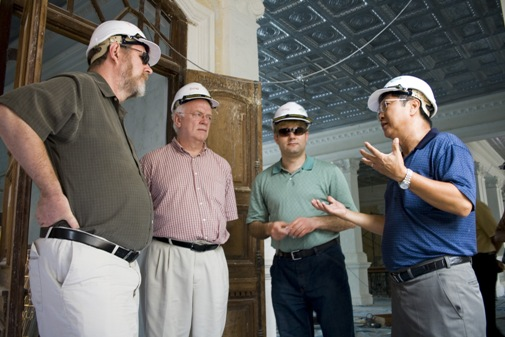 Deputy Vice Chancellor Prof Wong (right) explains the historical background of WOU's main campus.