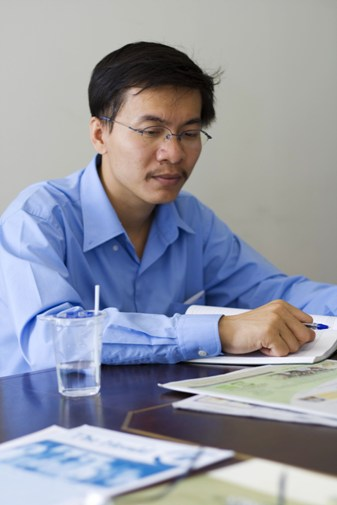 Prof Chan looks at a WOU advertisement published in  the Sun  on May 7.