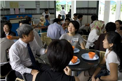 Prof Wong (left) chats with tutors during the tea break.