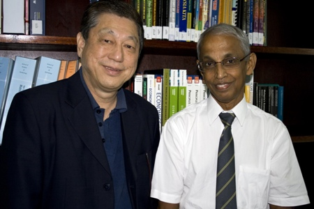 Prof Dhanarajan (right) with Dr Paul Chan.