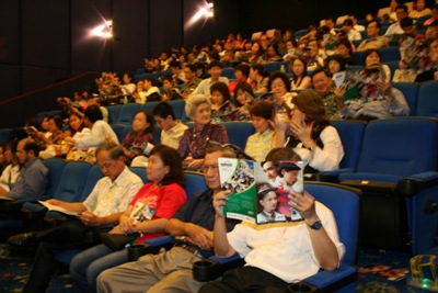 "Viewers in the cinema hall before screening of ""Road to Dawn""."
