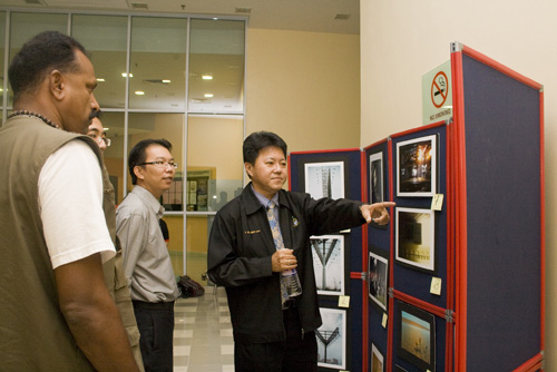 Viewing the photographs on display.