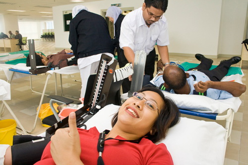 "Choy: ""This is my sixth time...donating blood is simple and quite painless."""