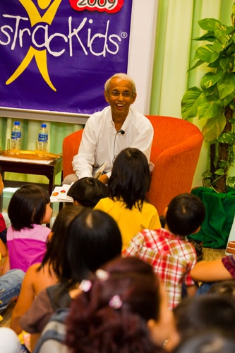Prof Dhanarajan vows the kids with tales about the hungry caterpillar.