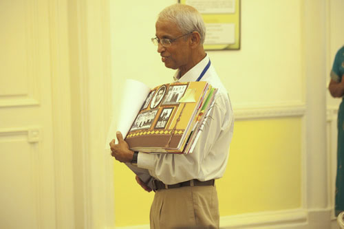 Prof Dhanarajan flips to show his childhood photos from his gift album.