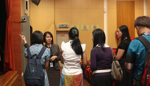 Corporate Communications Executive Wong Peng Lin (facing camera) takes the visitors on a tour of the maiin campus.