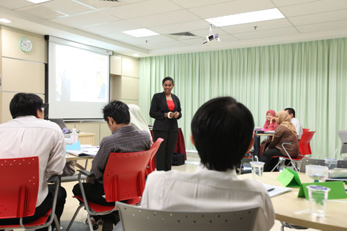 Catherine Lourdes conducts the training.