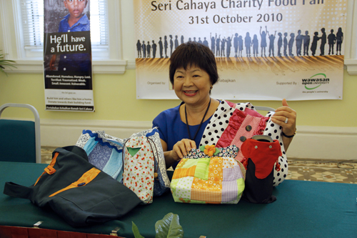 Puan Sri Sue Dhanarajan displays her hand-made bags.