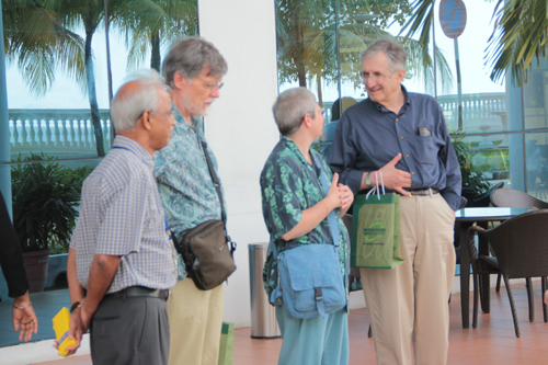 Tan Sri Emeritus Prof Gajaraj Dhanarajan with the guests at the alfresco area.