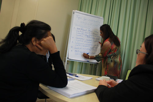 Jasmine Emmanuel writes on the board during the hands-on group exercise.