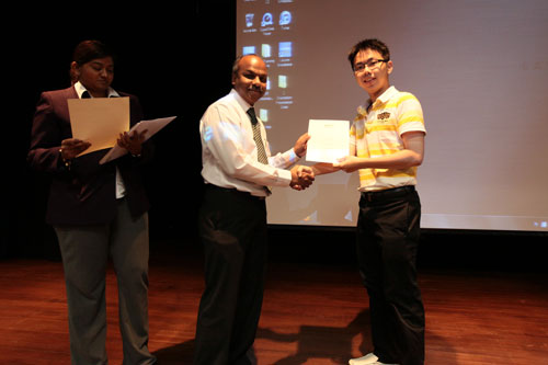 Prakash presents the Dean's List award at the main campus.