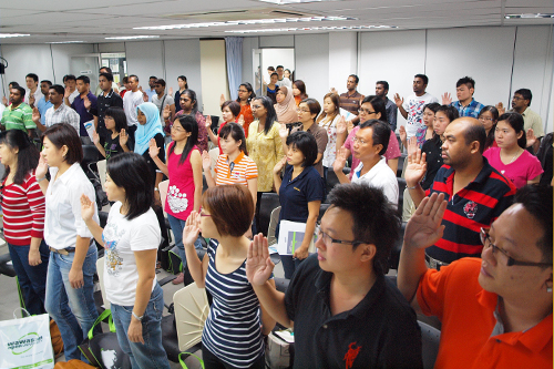 New students take the oath during Orientation in Ipoh.