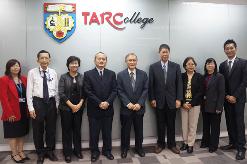 Prof Ho (centre) with senior staff of WOU and TAR UC.