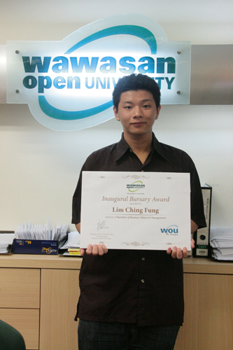 Lim with his award.