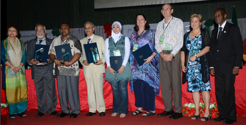 Prof Mohandas Menon (2nd from left) with the University's awards.