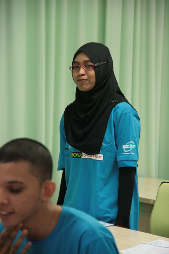 Fatin introducing herself during the orientation.