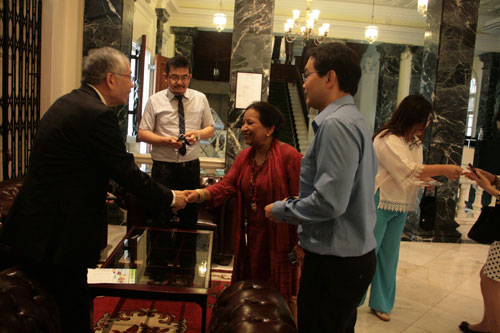 Prof Madhulika Kaushik (in red attire) greets the OUK delegation upon arrival at the Homestead.
