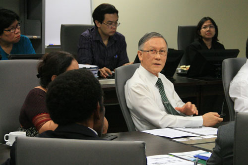 Prof Ho (in tie) responds to questions from the delegation.