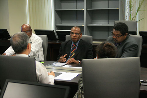 Head of the delegation, Mr Mabida (centre), in discussion.