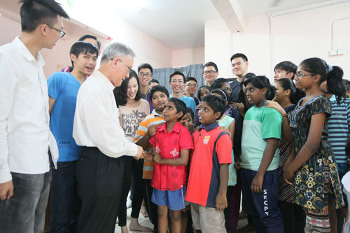 Prof Ho gets to know the kids as Lee Kah Wei (left) and the other full-time students look on.