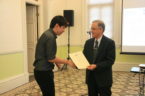 Chew Chin Quan receives the Dean's List award from Prof Ho.
